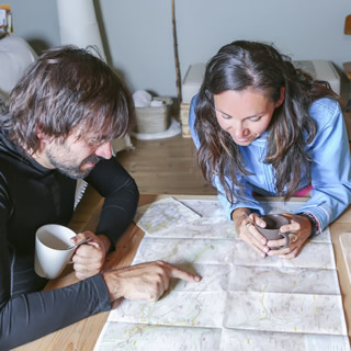Couple reading map to plan a walk
